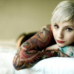 Girl-With-Tattoo-On-Bed-Background-